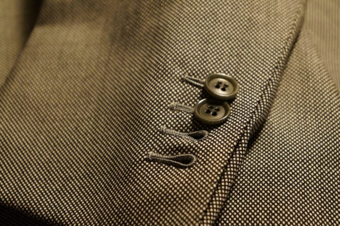What are those buttons on suit jackets for?